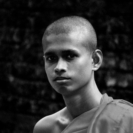 Mahanama_Thero_who_has_been_disciplined_by_the_school_of_Theravada_Buddhist_traditions_hasn't_still_completed_the_age_of_22._The_Thero_was_born_In_the_beautiful_remote_village_of_Bibiladeniya